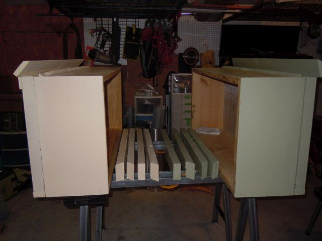 Two horizontal hive boxes and legs set out for painting