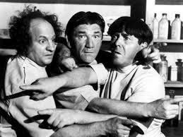 The Three Stooges pointing fingers in all directions