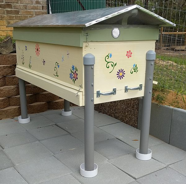 """Refurbished hive installed in new bee yard """"ditch"""" with ant traps ready to be filled with water."""
