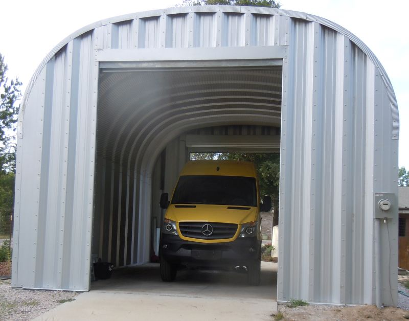 Rear of garage with van parked inside