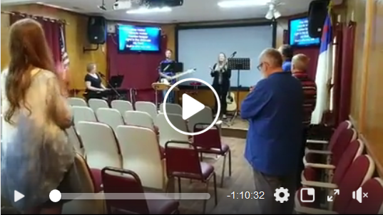 Still frame of church service linked to video on Facebook