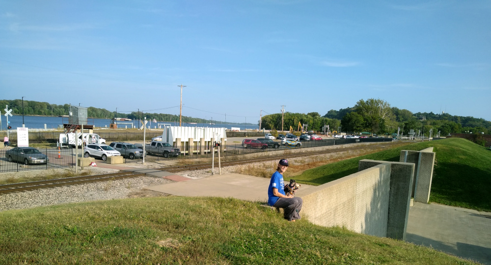 Sue sitting on the Hannibal levee.