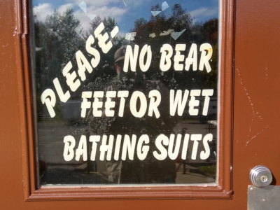 No bear (b e a r) feet sign at campground.