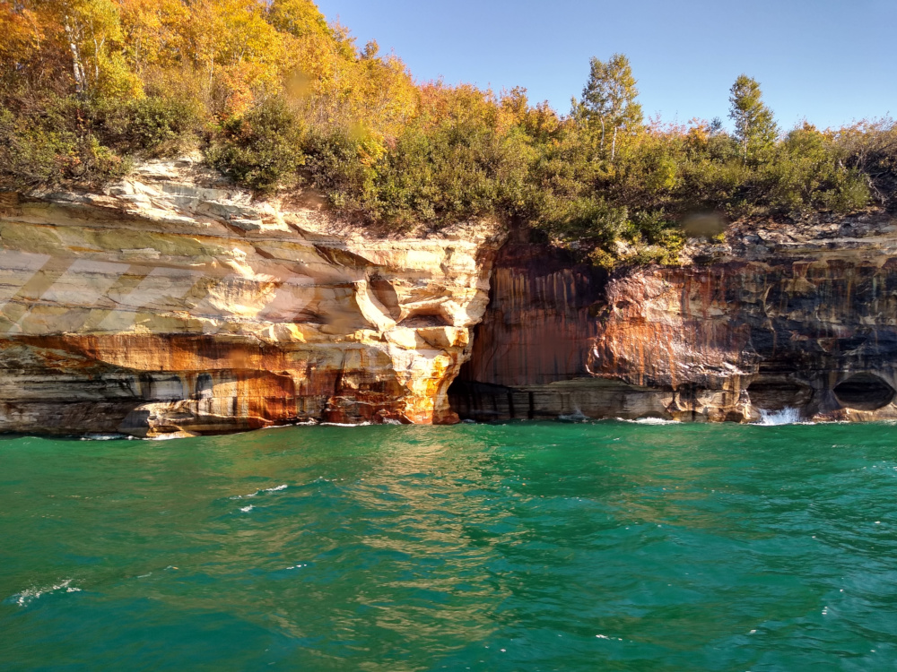 Shallow Caves at the Cliff Face with Turquoise Water
